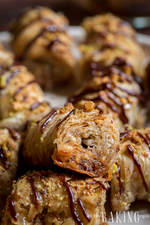 Pistachio-Walnut Baklava Rolls - thin layers of fillo dough layered with walnuts and pistachios, then rolled, baked and finished off by a pouring vanilla syrup over them. | by Let the Baking Begin!