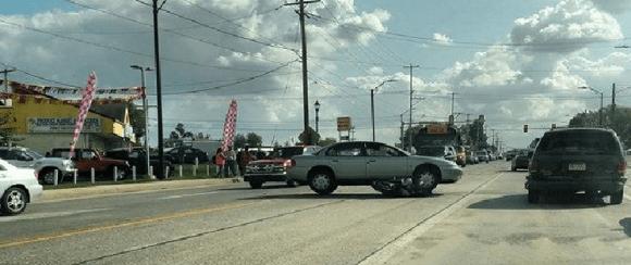 Motorcycle Ends Up Under Car In Crash