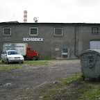 Old buildings adopted for commercial activity. The stainless steel box on wheels on the right is a garbage container (hasiok).