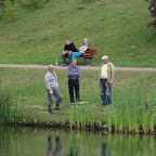 Anglers discussing their catch.