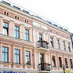 Renovated building facades on Wolności Street.