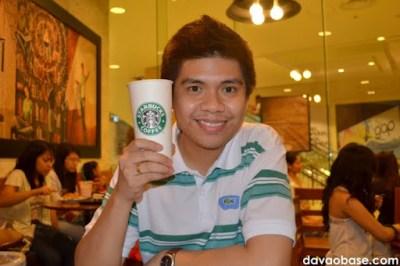 Hubby enjoying a Venti Hot White Chocolate Mocha at Starbucks Coffee in Abreeza Mall