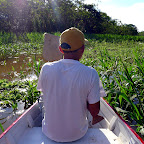 Sun brightly shines at mid-day as Herman navigates our way through the marsh in our boat.