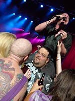 Mike Patton croons 'Ben' while sitting a large man who looks like he wants to make-out with the hairless tattoo chick.