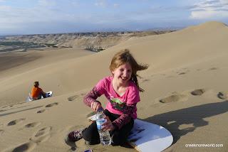 Emma loves the sandboarding in the Nazca desert.