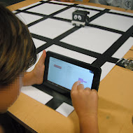 kid_using_tablet_to_program_infante_robot.JPG