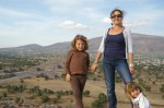 Nadia, Agnieszka and Alex standing on the top of the Pyramid of the Sun, Teotihuacan, Mexico. In the background, the Pyramid of the Moon and the plaza.