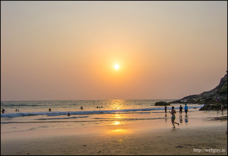 People enjoying the sunset at Kudle Beach, Gokarna
