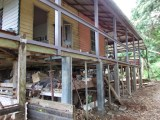 Rotten veranda wall demolished