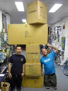 Nick and Lee, dwarfed by a Cassons delivery.. Look at all that Topeak.