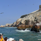 The boats skirt the rocky coasts of Islas Ballestas