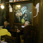The little sign reads 'Reserved for Bartolo and Giovanni', who like this painting enough to sit here every night.  Rawk!