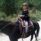 Lily gets more and more comfortable on the horse.