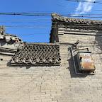 tile lattice between two buildings in a courtyard.JPG