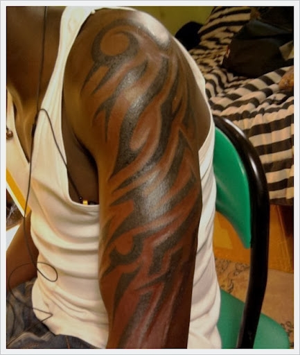tribal arm tattoos men