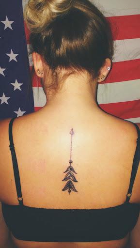 Arrow tattoos back