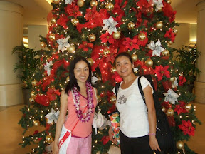 In front of the Christmas Tree in the Ala Moana Hotel lobby.