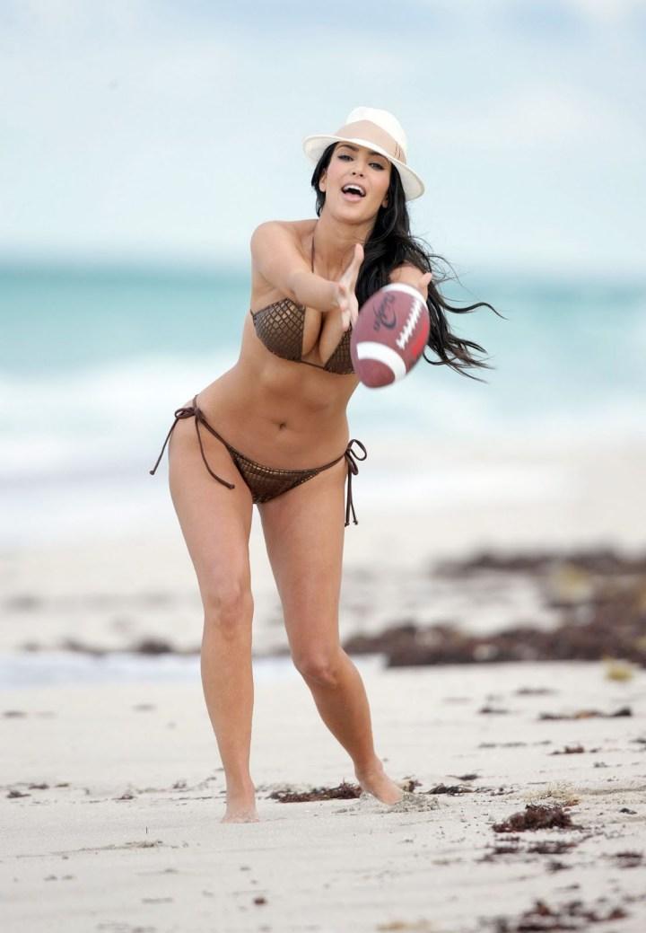 kim and kourtney kardashian on beach in miami white one piece swimsuit