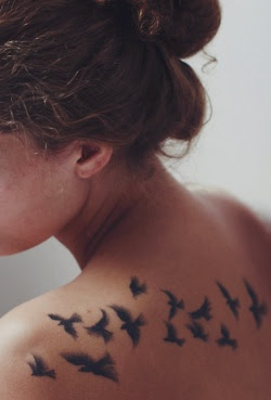 fllying bird tattoos