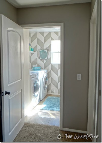 herringbone_pattern_painted_on_wall_laundry_room