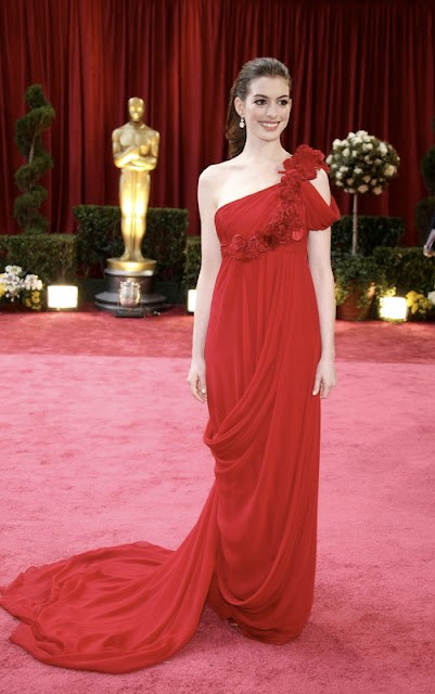 Anne Hathaway in a Red Marchesa gown