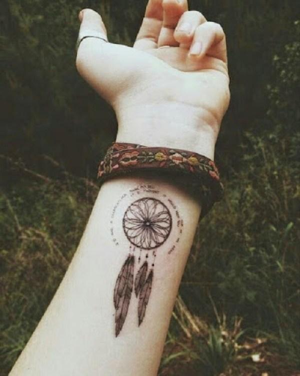 small dreamcatcher tattoo on wrist