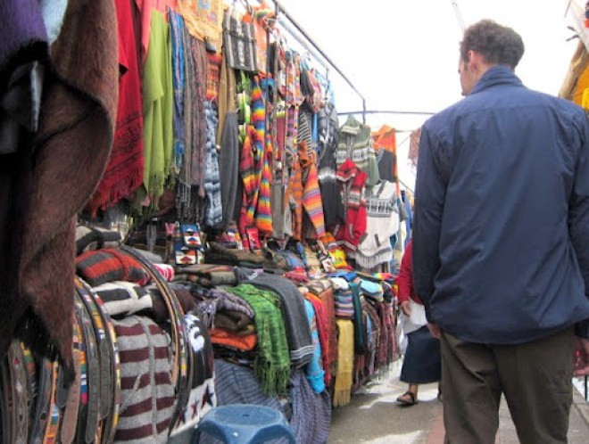 Jack walking among the hundreds of merchandise in Otavalo market, Ecuador