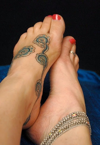 Cloud tattoos on foot