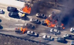 Cars are shown burning on the Interstate 15 freeway in the Cajon Pass, California in the frame grab from KNBC video July 17, 2015.  A brush fire burning in foothills north of Los Angeles overran a freeway in a mountain pass on Friday, torching several cars and trucks as drivers scrambled to safety.  REUTERS/NBCLA.COM/HANDOUT  FOR EDITORIAL USE ONLY. NOT FOR SALE FOR MARKETING OR ADVERTISING CAMPAIGNS  NO SALES NO ARCHIVES       TPX IMAGES OF THE DAY