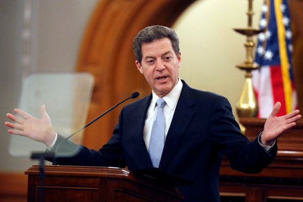 "Kansas Gov. Sam Brownback delivers his State of the State speech to an annual joint session of the House and Senate at the Statehouse in Topeka, Kan., Wednesday, Jan. 15, 2014. Brownback promised Kansas legislators Wednesday that the tax cuts he championed will spur economic growth and pay for various initiatives, including his all-day kindergarten proposal, saying the policies will build ""a state and an economy that works for everyone."" (AP Photo/Orlin Wagner)"