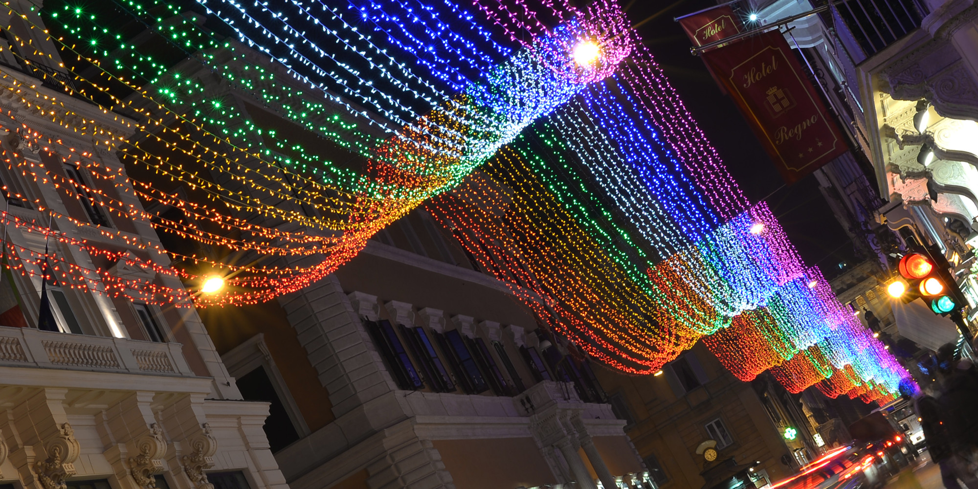 "Picture of Christmas lights taken in the Via del Corso, one of the main shopping street of Rome, on December 6, 2013. This year the illuminations are ""gay-friendly"" with a rainbow of colors enveloping the street. The six strips that change color from red to purple, symbol of the traditional ""rainbow flag"" and an expression of the homosexual movement, will make up the bright carpet of a mile and a half to get to Piazza Venezia to Piazza del Popolo. After the tricolor of 2011, on the occasion of the 150th anniversary of the Unification of Italy, and those white monochrome of 2012, Rome wants to send a message and stand in the front row as the capital of rights.  AFP PHOTO / GABRIEL BOUYS        (Photo credit should read GABRIEL BOUYS/AFP/Getty Images)"