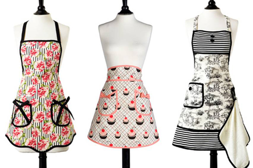 Photo by Jessie Steele, from left to right: Bib Ava Cabbage Rose Apron, Half Audrey Cherry Cupcakes Apron, Bib Gigi French Toil Apron with Terry Towel