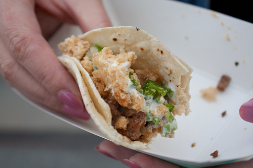 Adobo Hobo's Sisig Tacos topped with Chicharrones