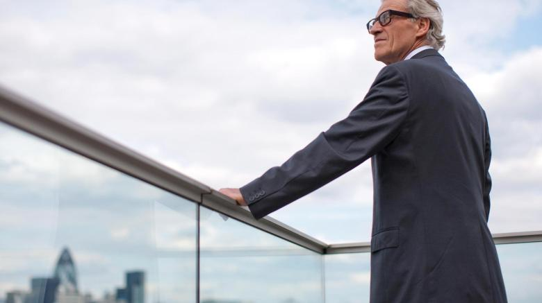 older-man-in-suite-executive-pondering-succession-planning