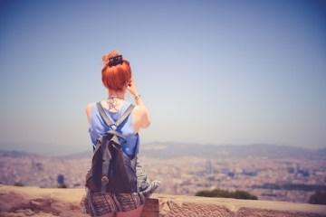 city-woman-view-blue-sky