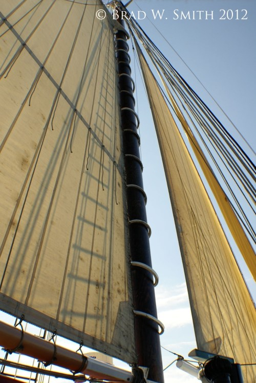 The Promise of Discovery, Brad W. Smith photographer LifeIsHOTBlog, upshot of two sails against a blue sky