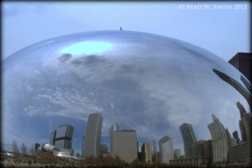 mirror-like surfaces of the 110-ton elliptical sculpture reflect passers-by as well as the Chicago skyline and sky