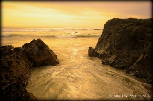 rocks form small inlet; water swirls