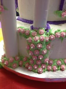 Cake tower emergency - nothing a little wall of ivy, flowers and dental floss can't fix!