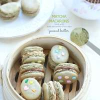 Matcha Macarons filled with White and Dark Chocolate Peanut Butter Frosting