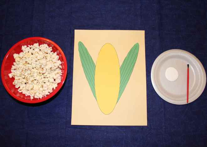 Glue on Small Plate and Popcorn in Bowl next to paper corn cob.