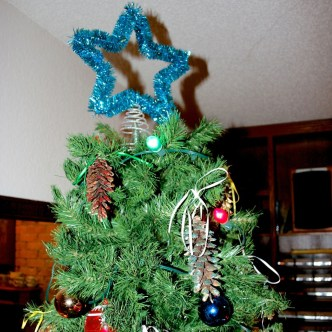 Tree top with decorated pine cones