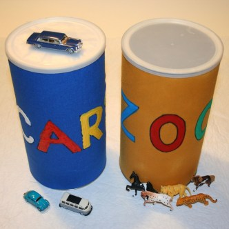 Two homemade canisters for storing toys are shown.