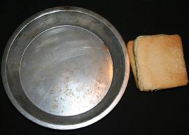 Image shows a pie tin and pieces of bread.
