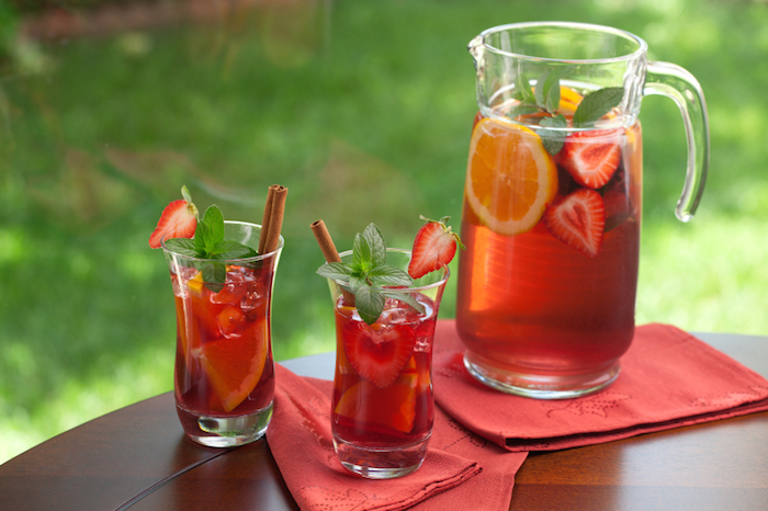 Closeup of two glass of spicy strawberry Sangria on outside table.