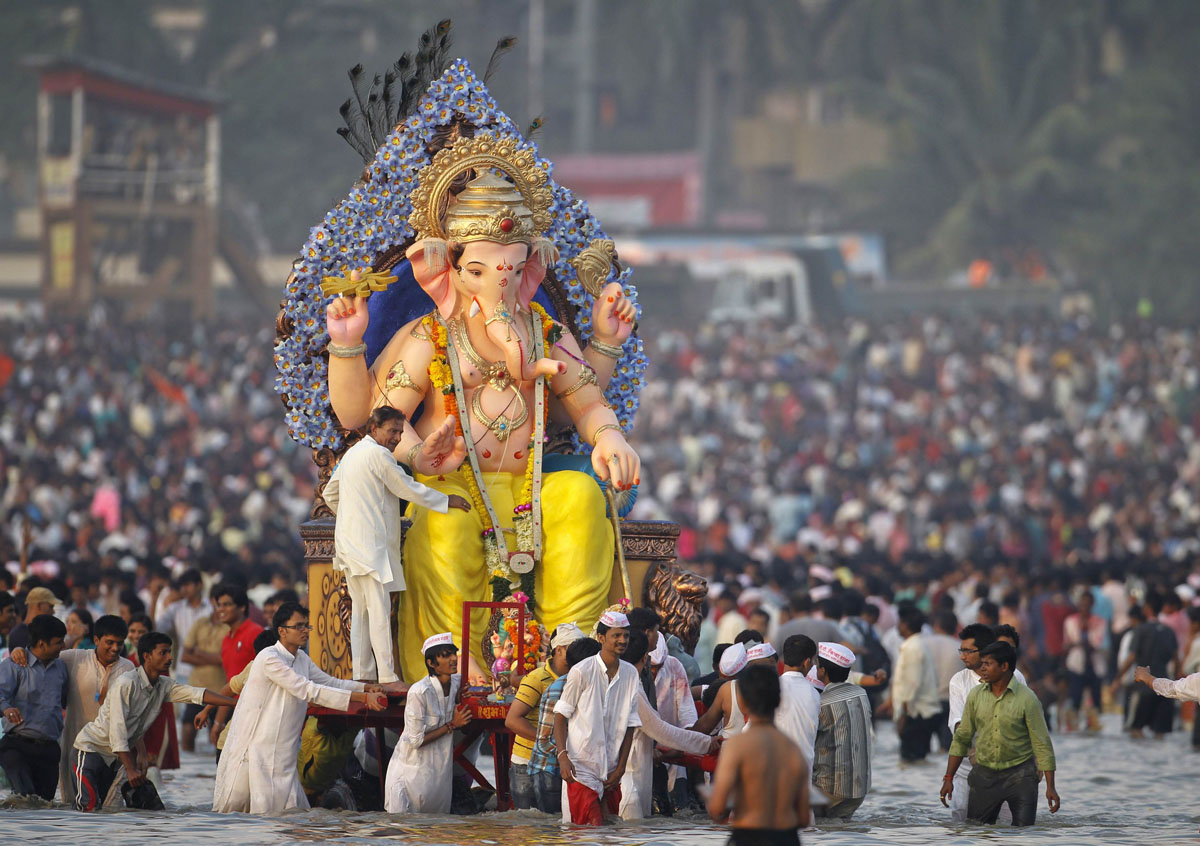 ganesh chaturthi celebrations across the country light art academy devotees carry an idol of the hindu elephant god ganesh for immersion into the arabian sea