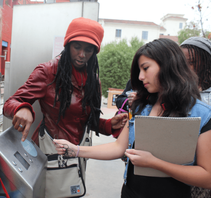 The young artists learn how to load and use their Metro travel cards