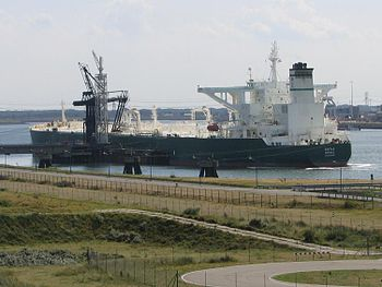 English: Crude oil tanker SAFWA moored off Rot...