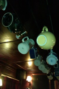 For Some reason there are a lot of jugs hanging from the ceiling in the Avon bar.