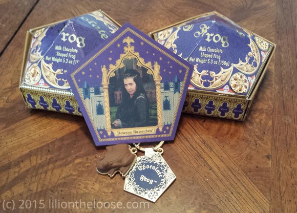 A Rowena Ravenclaw trading card, Chocolate Frog boxes, and a Chocolate Frog keychain.